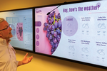 Capture d'écran pour AxisTV Signage Suite : Our digital signage software has a Voice Recognizer Widget that turns any screen into a hands-free interactive sign. Viewers can walk up to any display, ask for the material they want, and then immediately see that content on screen.