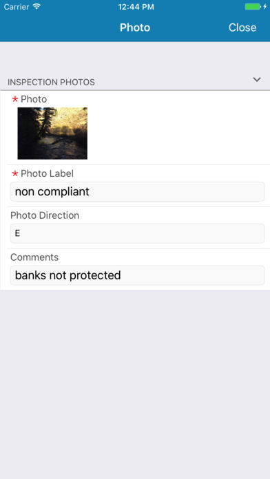 The Kordata app on iOS showing the ability to attach photo evidence from camera to inspection notes