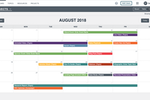 Demand Metric screenshot: The calendar shows a color-coded view of all tasks and projects